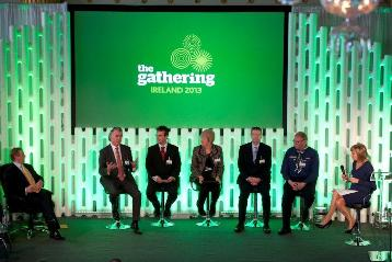 Panel on stage with An Taoiseach left, Mary Kennedy right and Adrian Gallagher 4th left of the panellists.